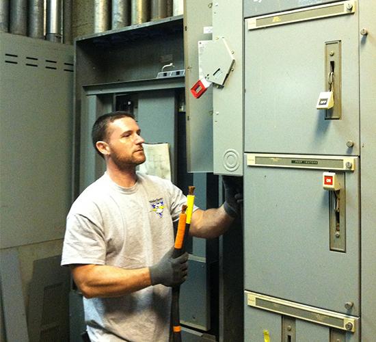 Electrician Reparing a Fusebox