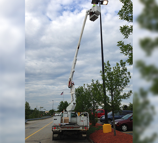 Electrician Fixing The Street Light