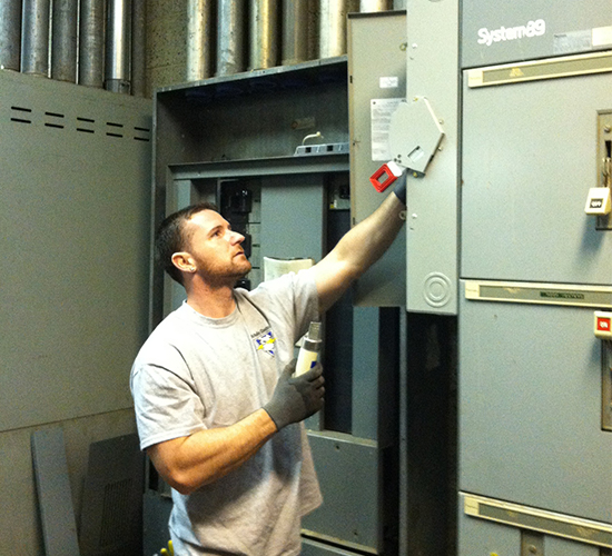 Electrician Working on a Fusebox